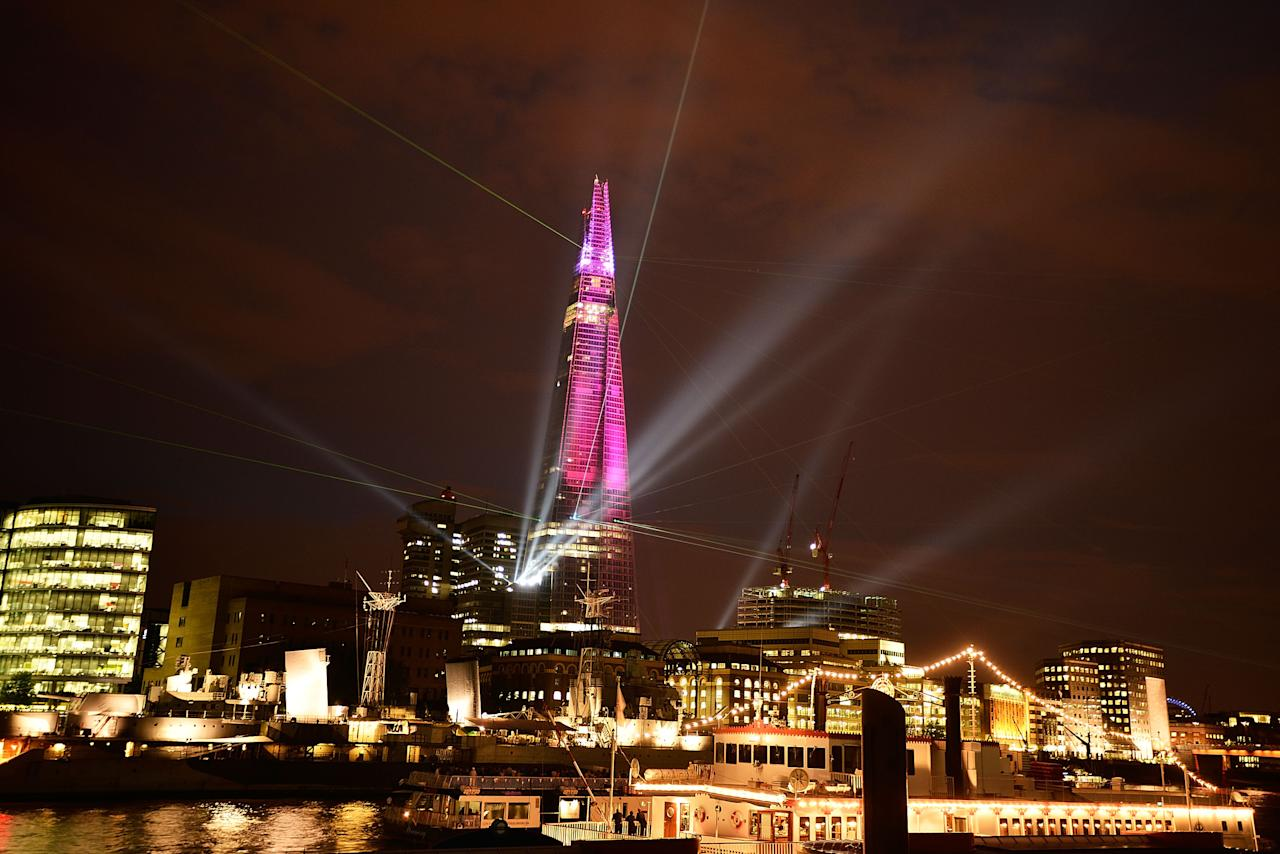 The Shard is seen lit up during a laser light show from Tower Millennium Pier on July 5, 2012 in London, England. The European Union's highest building designed by Italian architect Renzo Piano, stands at 310 meters tall situated on London's Southbank is formally inaugurated this evening at 10pm with a laser show that will also be streamed live on the internet.  (Photo by Bethany Clarke/Getty Images)