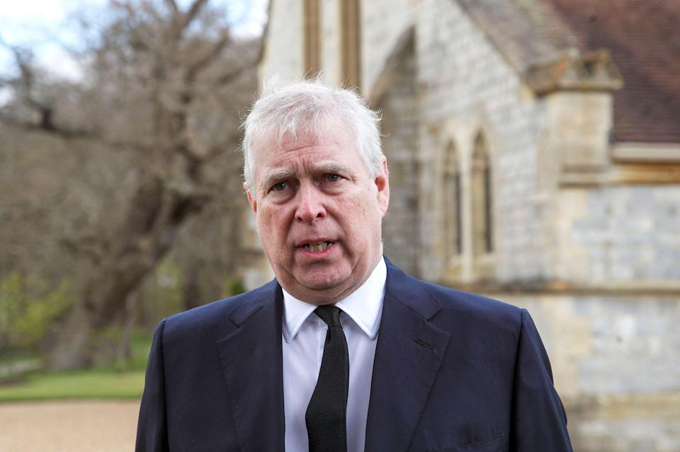 """Two days after his father's death, Prince Andrew tells reporters outside the Royal Chapel of All Saints in Windsor that the loss of Prince Philip has left """"a huge void"""" in Queen Elizabeth II's life."""