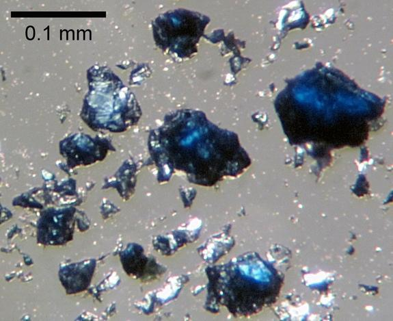 Fragments of the blue-colored mineral ringwoodite synthesized in the laboratory.