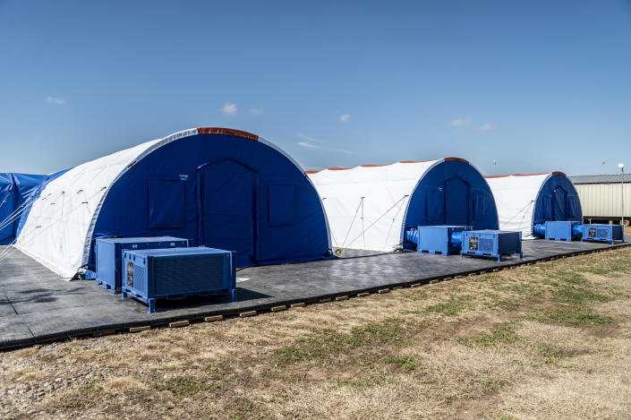 Intensive care tents sit in a row at a Influx Care Facility (ICF) for unaccompanied children on Sunday, Feb. 21, 2021 in Carrizo Springs, TX. / Credit: The Washington Post