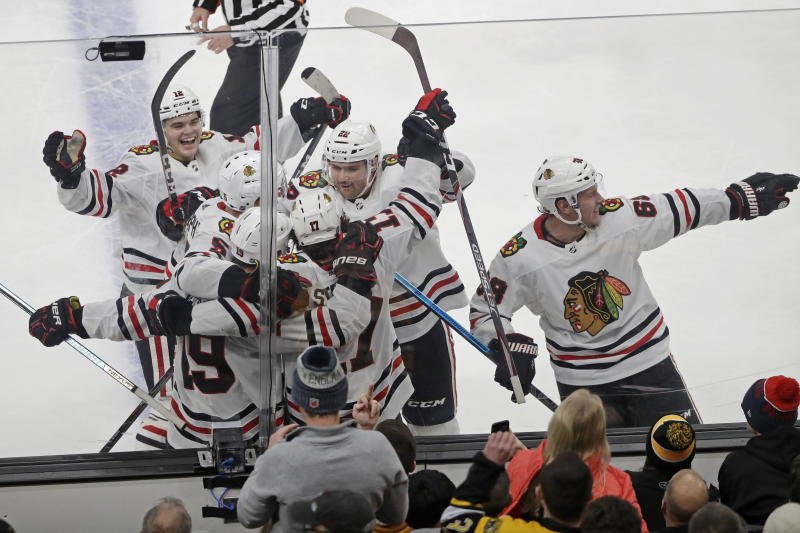 Blackhawks recover, beat Bruins 4-3 in OT