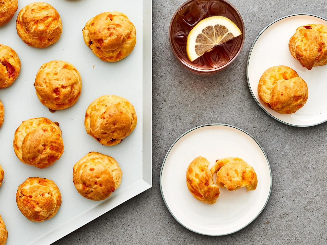 "<p>Classic French gougères with a Southern remix. These airy pimiento cheese puffs make an impressive addition to virtually any party spread. While the choux pastry dough may seem intimidating to make, trust us—success is just a matter of not walking away from the pan. As long as you can stay put and keep stirring (so that your dough doesn't burn), you can make gougères. </p> <p><a href=""https://www.myrecipes.com/recipe/pimento-cheese-puffs"">Pimento Cheese Puffs Recipe</a></p>"