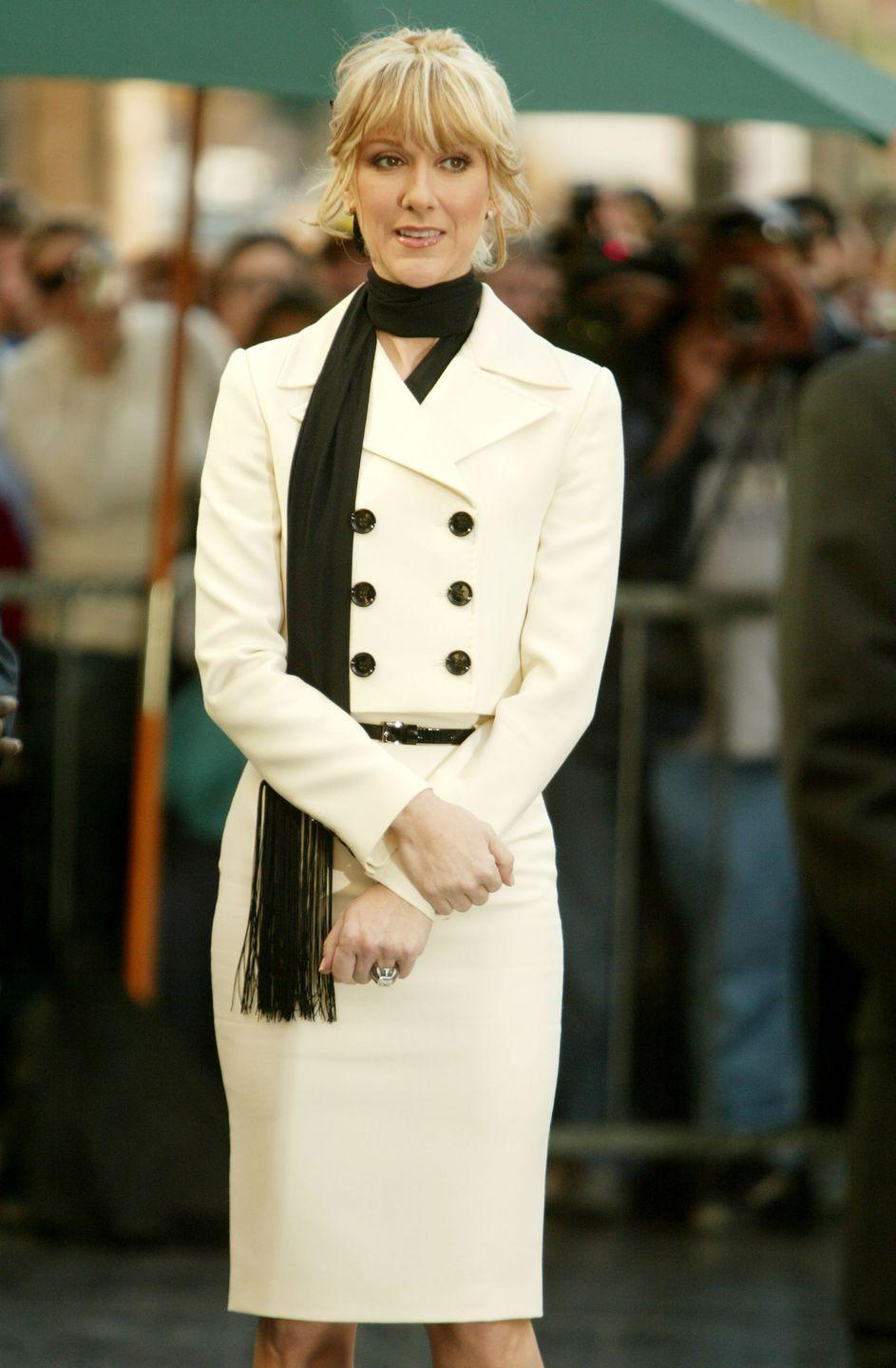 <p>On the day she received her star on the Hollywood Walk of Fame, Celine wore a structured ivory and black suit. Her hair framed her face in a low pony, which gave the look a more playful feel. </p>
