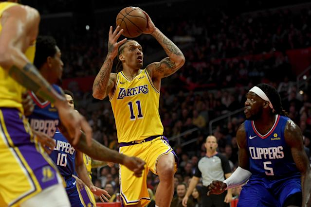 Michael Beasley, who was suspended five games for violating the NBA's drug policy, reportedly has an offer to head overseas. (Getty Images)