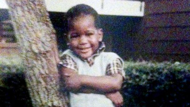 PHOTO: Young Karamo Brown poses in front of his house. 'I was a very happy child.' (Karamo Brown)