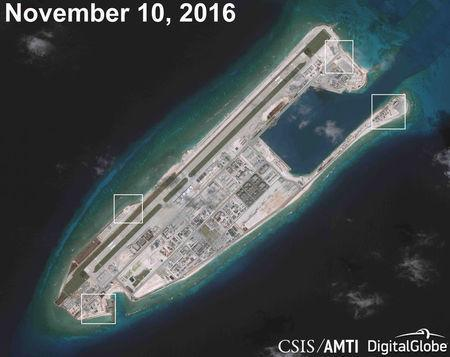 A satellite image shows what CSIS Asia Maritime Transparency Initiative says appears to be anti-aircraft guns and what are likely to be close-in weapons systems (CIWS) on the artificial island Fiery Cross Reef in the South China Sea in this image released on December 13, 2016. Courtesy CSIS Asia Maritime Transparency Initiative/DigitalGlobe/Handout via REUTERS