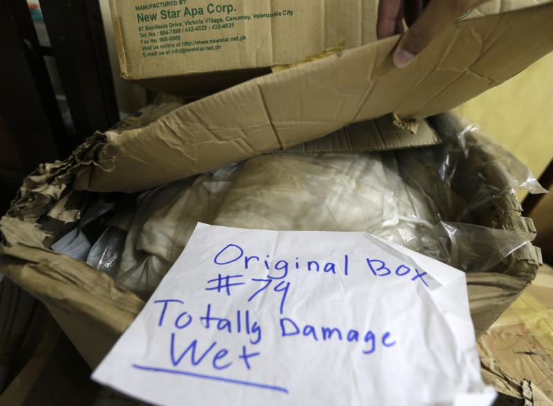 In this photo taken Sept. 19, 2012, a label is placed on items such as shoes, bags, gowns and native attires those once had been worn by flamboyant former Philippine first lady Imelda Marcos in a section of the National Museum in Manila, Philippines. Termites, storms and government neglect have damaged some of Imelda Marcos's legendary stash of shoes, expensive gowns and other vanity possessions, which were left to oblivion after she and her dictator husband were driven to U.S. exile by a 1986 popular revolt. (AP Photo/Bullit Marquez)