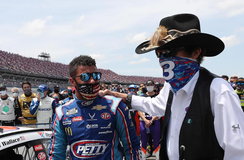 Bubba Wallace, driver of the No. 43 Victory Junction Chevrolet, and team owner Richard Petty look on after NASCAR drivers pushed Wallace to the front of the grid as a sign of solidarity with the driver prior to the NASCAR Cup Series GEICO 500 at Talladega Superspeedway on Monday. (Photo by Chris Graythen/Getty Images)