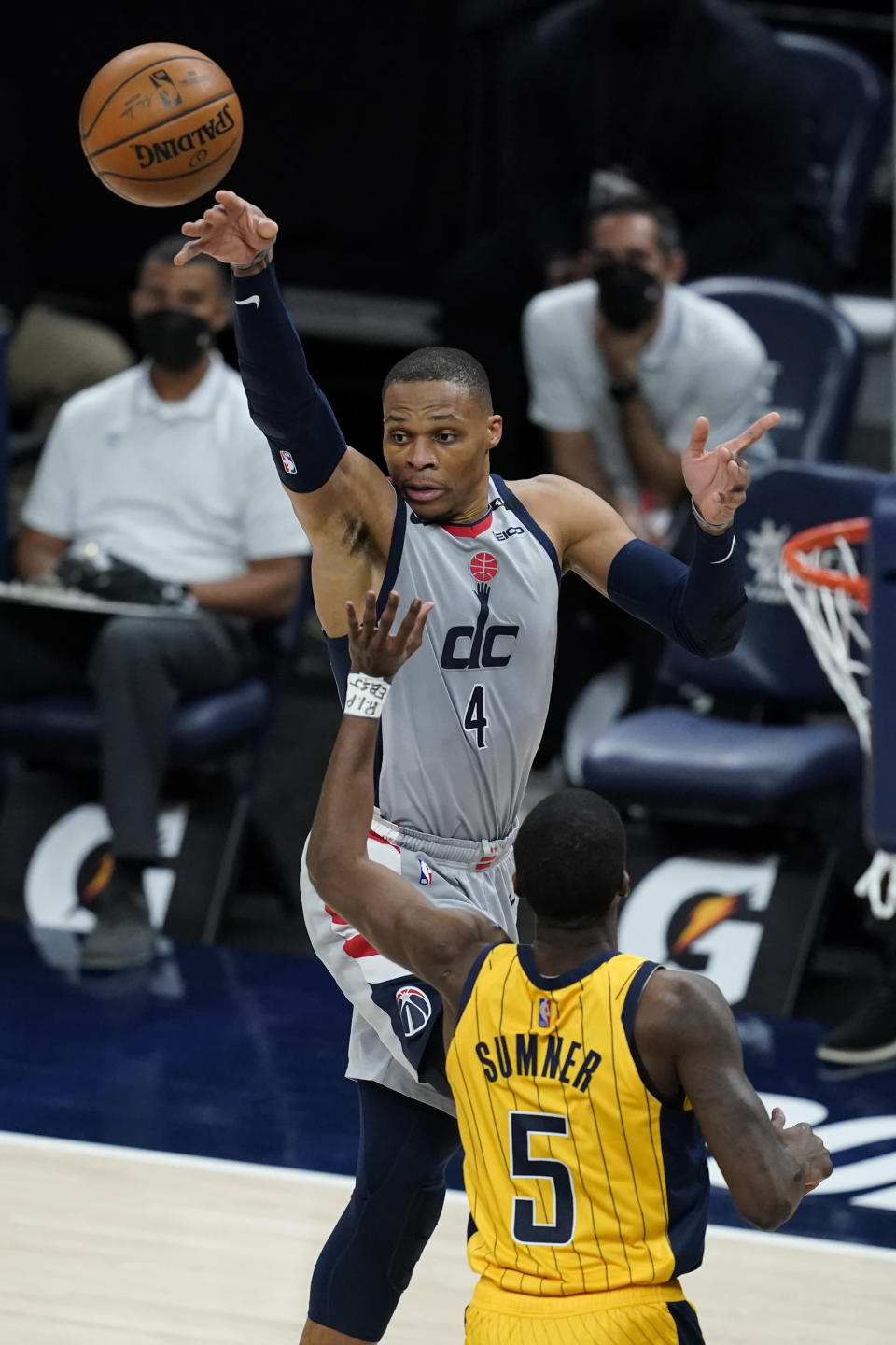 Washington Wizards' Russell Westbrook (4) makes a pass against Indiana Pacers' Edmond Sumner (5) during the first half of an NBA basketball game, Saturday, May 8, 2021, in Indianapolis. (AP Photo/Darron Cummings)