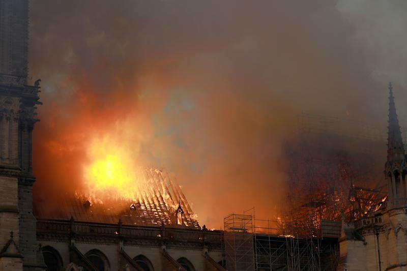 Flames and smoke are seen billowing from the roof at Notre-Dame Cathedral April 15, 2019 in Paris, France. (Photo: Pierre Suu/Getty Images)