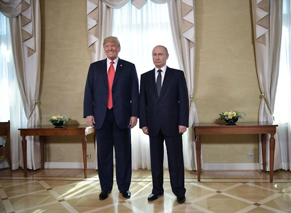 US President Donald Trump (left) and Russia's President Vladimir Putin pose ahead a meeting in Helsinki, on July 16, 2018.