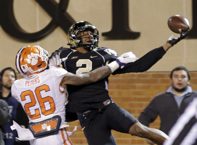Wake Forest's Matt James (2) misses a catch as Clemson's Garry Peters (26) defends during the second half of an NCAA college football game in Winston-Salem, N.C., Thursday, Nov. 6, 2014. (AP Photo/Chuck Burton)