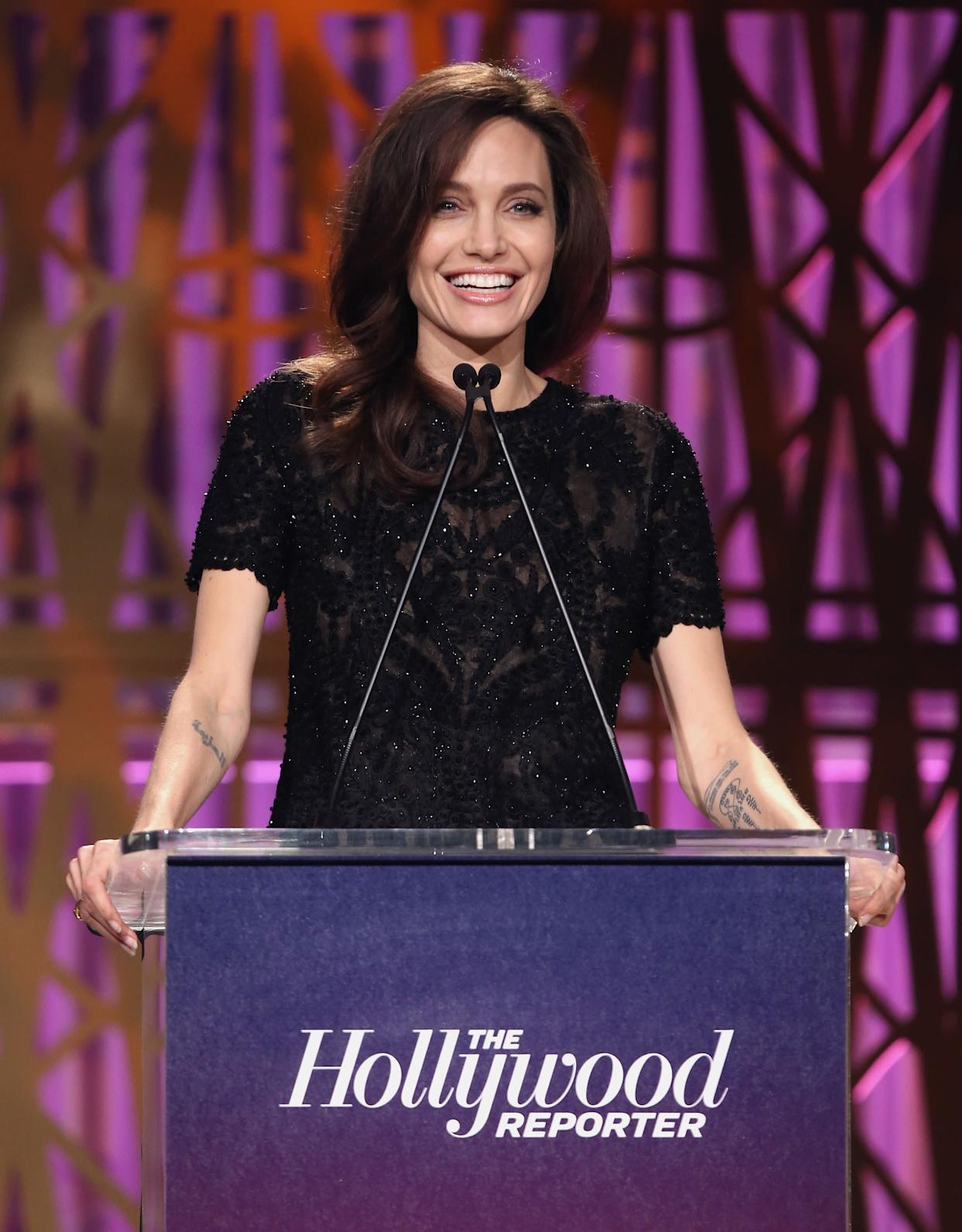 LOS ANGELES, CA - DECEMBER 06: Angelina Jolie speaks onstage at The Hollywood Reporter's 2017 Women In Entertainment Breakfast at Milk Studios on December 6, 2017 in Los Angeles, California. (Photo by Jesse Grant/Getty Images)