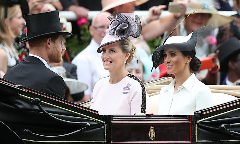 The Duke and Duchess of Sussex arrive alongside Sophie, Countess of Wessex.  (DANIEL LEAL-OLIVAS via Getty Images)