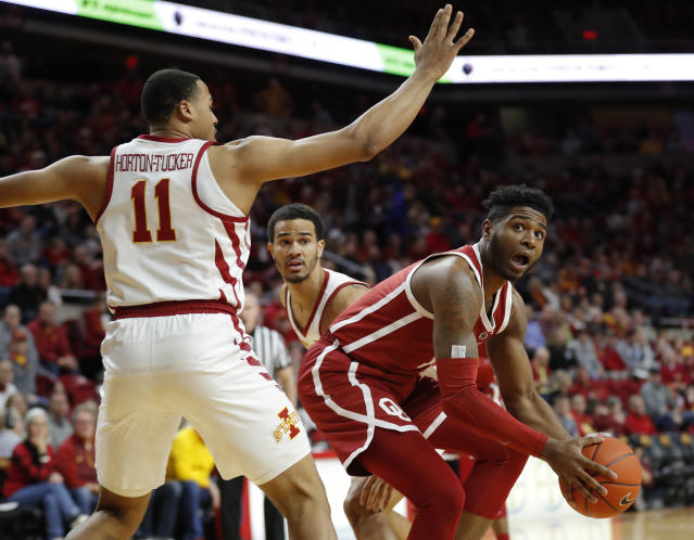 Oklahoma guard Rashard Odomes, right, drives around Iowa State guard Talen Horton-Tucker (11) during the first half of an NCAA college basketball game, Monday, Feb. 25, 2019, in Ames, Iowa. (AP Photo/Charlie Neibergall)