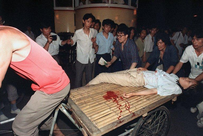 This photo taken on June 4, 1989 shows a girl wounded during clashes between the army and students near Tiananmen Square in Beijing. The dissident author and poet Liao Yiwu was imprisoned a year later for writing a poem about it
