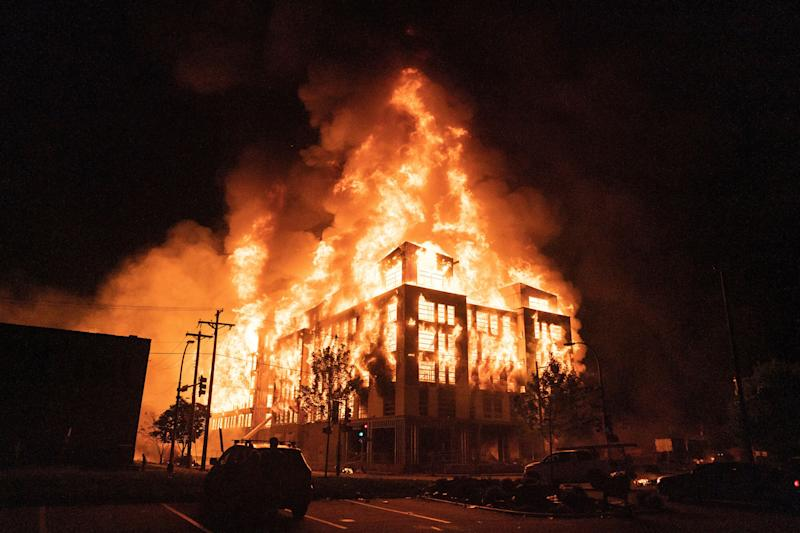 <strong>A multi-story affordable housing complex under construction near the Third Precinct, burns on Wednesday night in Minneapolis.</strong> (Photo: ASSOCIATED PRESS)