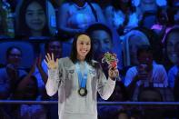 Torri Huske reacts at the nedal ceremony after winning the Women's 100 Butterfly during wave 2 of the U.S. Olympic Swim Trials on Monday, June 14, 2021, in Omaha, Neb. (AP Photo/Charlie Neibergall)