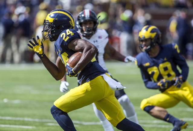 "Michigan defensive back <a class=""link rapid-noclick-resp"" href=""/ncaaf/players/271100/"" data-ylk=""slk:Lavert Hill"">Lavert Hill</a> (24) had seven tackles in the loss to Penn State. (AP Photo/Tony Ding)"