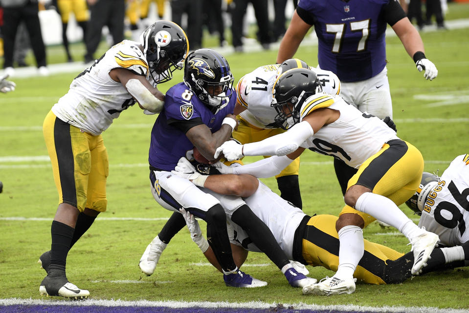 Baltimore Ravens quarterback Lamar Jackson (8) is stopped short of the goal line by a host of Pittsburgh Steelers defenders during the first half of an NFL football game, Sunday, Nov. 1, 2020, in Baltimore. (AP Photo/Nick Wass)