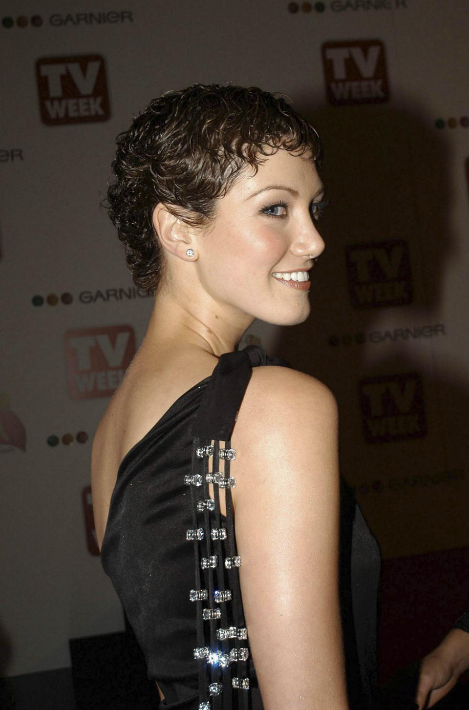 18 April 2004 - DELTA GOODREM wearing a black jersey creation by fashion designer PETER- MORRISSEY, with diamonds sparkling from three strands hanging from the shoulder over her back ,  arriving at the 46th TV Week Logie Awards  at the Crown Casino -  Melbourne, Victoria, Australia. (Photo by Regis Martin/Getty Images)