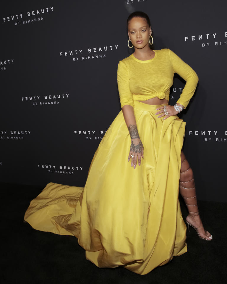 <p>Only Rihanna could pull off a full yellow look. Her custom Oscar de la Renta crop top and balloon skirt were the talk of the week.<br /><i>[Photo: AP]</i> </p>