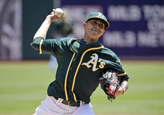 Oakland Athletics starting pitcher Jesse Chavez throws to the Detroit Tigers during the first inning of a baseball game Thursday, May 29, 2014, in Oakland, Calif. (AP Photo/Marcio Jose Sanchez)