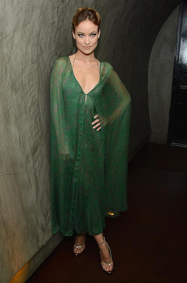 "Olivia Wilde's emerald-hued Calvin Klein cape dress ... Green Lantern alluring or Green Goblin gross? (9/27/2012)<br><br><a target=""_blank"" href=""http://movies.yahoo.com/movie/butter/"">See the trailer for Olivia's new movie, ""Butter""</a>"