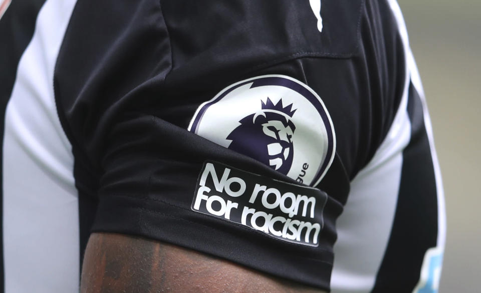 """FILE - In this Sunday, Sept. 20, 2020 file photo, Aadetailed view of the """"No room for racism"""" badge on the shirt of Newcastle United's Callum Wilson during the English Premier League soccer match between Newcastle United and Brighton at St. James' Park in Newcastle, England. The leaders of English soccer have asked the heads of Facebook and Instagram to show """"basic human decency"""" by taking more robust action to eradicate racism and for users' identities to be verified. There has been growing outrage that players from the Premier League to the Women's Super League have been targeted with abuse on Twitter and Facebook-owned Instagram. (Alex Pantling /Pool via AP, File)"""