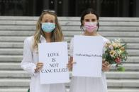 People march to Government Buildings in a bid to allow up to 100 guests to attend their weddings this year in Dublin