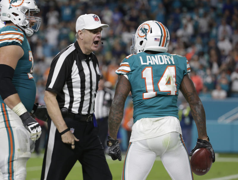 Referee Jeff Triplette ejects Dolphins wide receiver Jarvis Landry from the game for unsportsmanlike conduct. (AP)