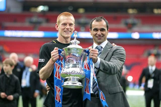 Goalscorer Ben Watson and manager Roberto Martinez post with the FA Cup in 2013 (Dave Thompson/PA)