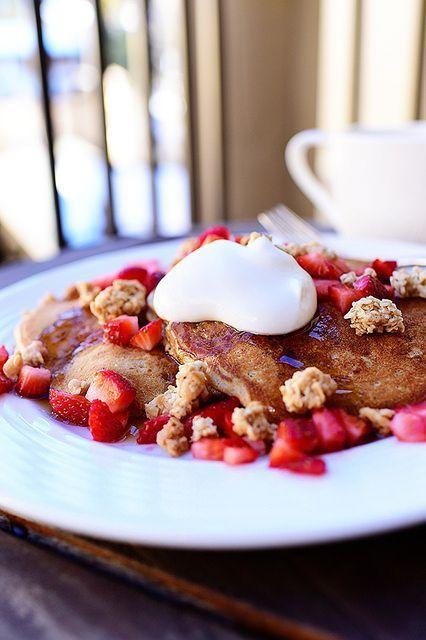 """<p>These pancakes may look decadent, but they're filled with plenty of whole grains and fresh fruit. The secret ingredient? Whole-grain pancake mix!</p><p><strong><a href=""""https://www.thepioneerwoman.com/food-cooking/recipes/a11982/strawberry-granola-pancakes/"""" rel=""""nofollow noopener"""" target=""""_blank"""" data-ylk=""""slk:Get the recipe."""" class=""""link rapid-noclick-resp"""">Get the recipe.</a></strong></p><p><a class=""""link rapid-noclick-resp"""" href=""""https://go.redirectingat.com?id=74968X1596630&url=https%3A%2F%2Fwww.walmart.com%2Fsearch%2F%3Fquery%3Dpioneer%2Bwoman%2Bmeasuring%2Bspoons&sref=https%3A%2F%2Fwww.thepioneerwoman.com%2Ffood-cooking%2Fmeals-menus%2Fg34922086%2Fhealthy-breakfast-ideas%2F"""" rel=""""nofollow noopener"""" target=""""_blank"""" data-ylk=""""slk:SHOP MEASURING SPOONS"""">SHOP MEASURING SPOONS</a><strong><br></strong></p>"""