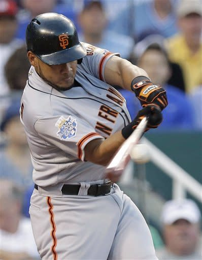 National League's Melky Cabrera, of the San Francisco Giants, hits a two-run home run during the fourth inning of the MLB All-Star baseball game Tuesday, July 10, 2012, in Kansas City, Mo. (AP Photo/Charlie Riedel)