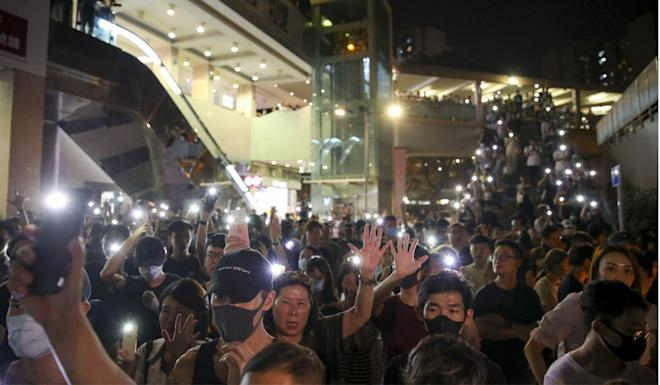 Protesters gather in Sheung Shui to mourn a 15-year-old girl who had been reported missing. Photo: Winson Wong