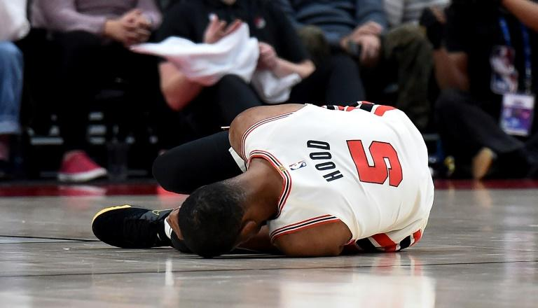 Portland's Rodney Hood lies on the court after suffering a torn left Achilles tendon in the first half of the Trail Blazers' NBA loss to the Los Angeles Lakers (AFP Photo/Steve DYKES)