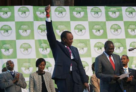 Incumbent President Uhuru Kenyatta reacts after he was announced winner of the presidential election at the IEBC National Tallying centre at the Bomas of Kenya, in Nairobi