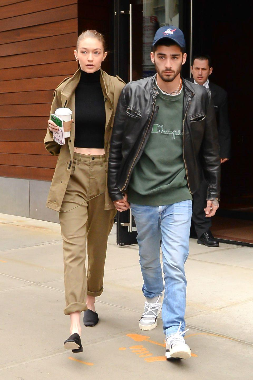 <p>In a black turtleneck crop with an oversized cargo jacket, loose-fitting pants and black leather mules while leaving her NYC apartment with her boyfriend Zayn.</p>