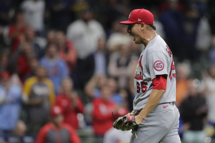 St. Louis Cardinals' Giovanny Gallegos reacts after striking out the final batter of the game to record a save during the ninth inning of a baseball game against the Milwaukee Brewers Tuesday, Sept. 21, 2021, in Milwaukee. (AP Photo/Aaron Gash)