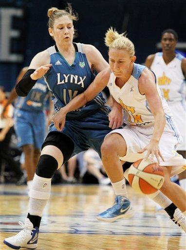 Chicago Sky guard Courtney Vandersloot, right, tries to maneuver around Minnesota Lynx guard Lindsay Whalen, left, during the first half of a WNBA basketball game, Saturday June 23, 2012, in Minneapolis. (AP Photo/Genevieve Ross)