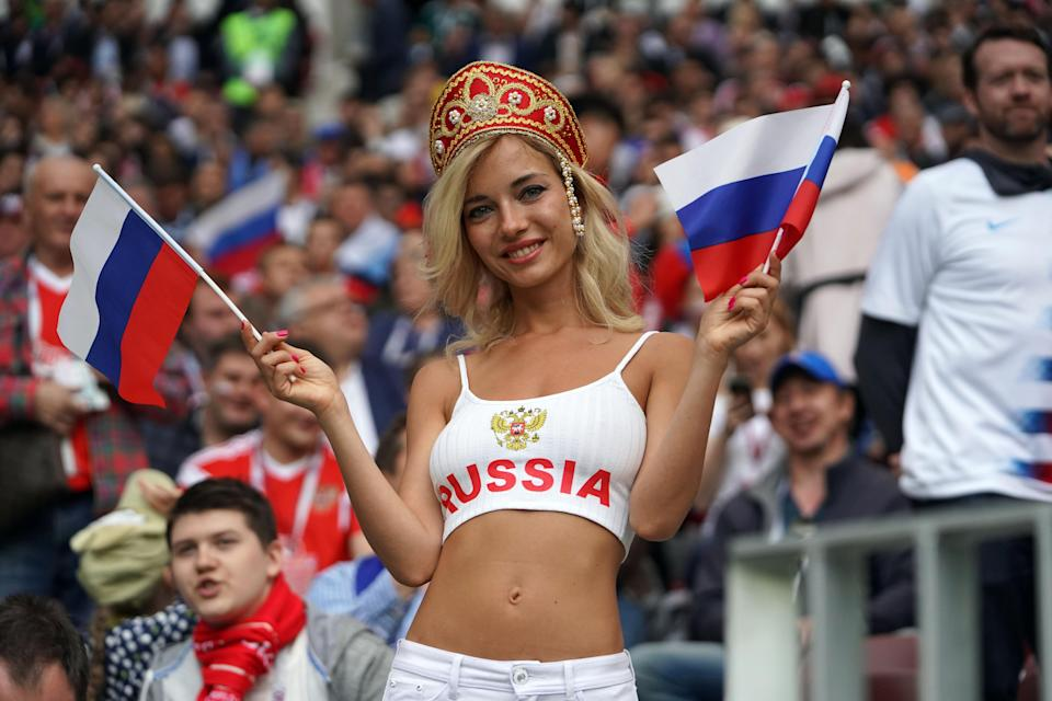 <p>Fans cheer during the Opening Ceremony during the 2018 FIFA World Cup Russia group A match between Russia and Saudi Arabia at Luzhniki Stadium on June 14, 2018 in Moscow, Russia. (Photo by Mao Jianjun/China News Service/VCG via Getty Images) </p>