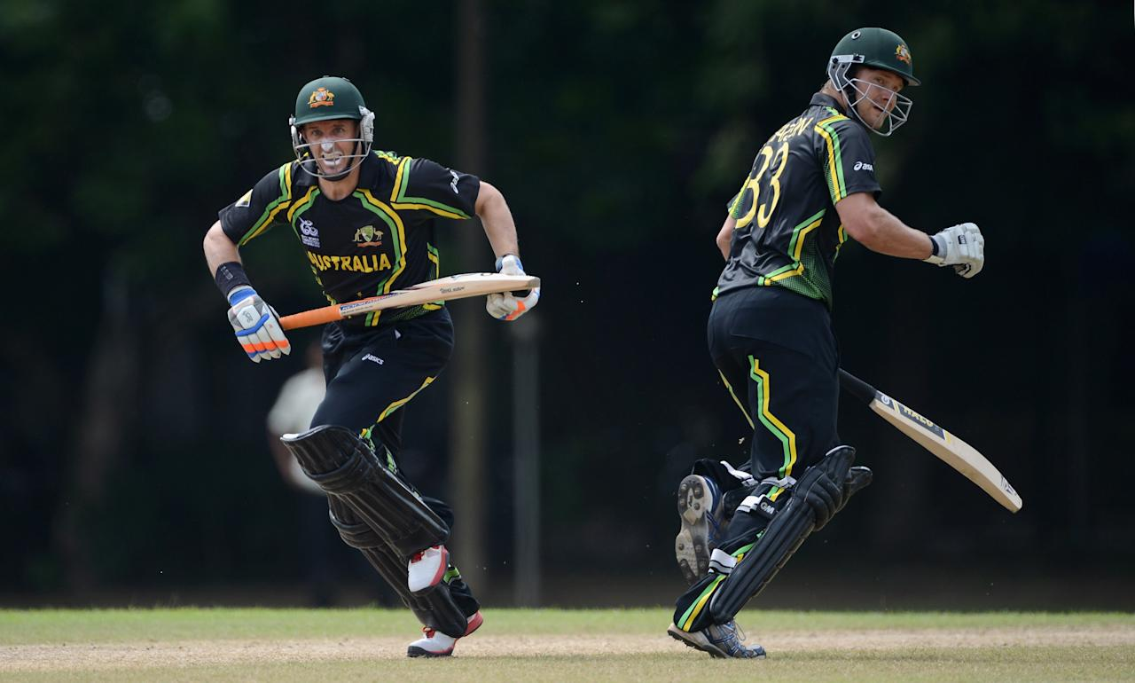 COLOMBO, SRI LANKA - SEPTEMBER 15:  Mike Hussey and Shane Watson of Australia run between the wickets during the T20 World Cup Warm Up Match between Australia and New Zealand at Nondescripts Cricket Club on September 15, 2012 in Colombo, Sri Lanka.  (Photo by Gareth Copley/Getty Images,)