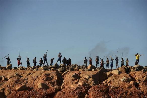 A group of Amazon Indians protests on an earth barrier that is part of the construction of the massive Belo Monte hydroelectric dam, in Vitoria do Xingu July 7, 2012.