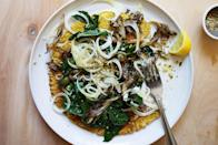 """This savory gluten-free vegetarian pancake recipe can be made in the same pan as the wilted greens, maximizing efficiency for a healthy weeknight meal. <a href=""""https://www.epicurious.com/recipes/food/views/cromlet-with-wilted-greens-and-fennel-and-olive-salad?mbid=synd_yahoo_rss"""" rel=""""nofollow noopener"""" target=""""_blank"""" data-ylk=""""slk:See recipe."""" class=""""link rapid-noclick-resp"""">See recipe.</a>"""