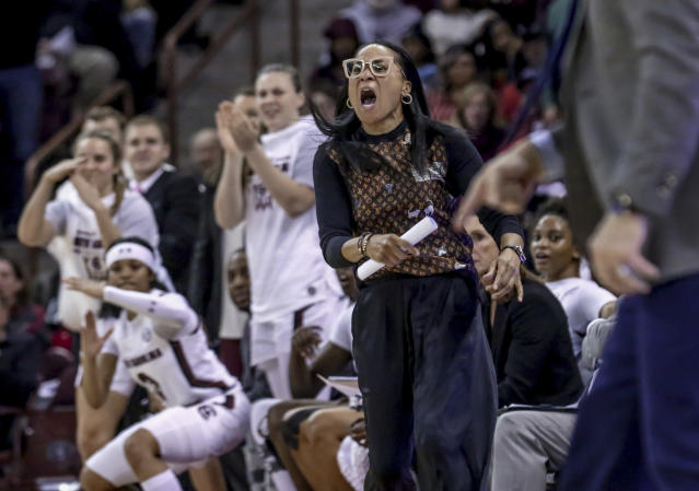 South Carolina coach Dawn Staley dispute a call during the second half of an NCAA college basketball game against Kentucky, Thursday, Jan. 2, 2020 in Columbia, S.C. (Tracy Glantz/The State via AP)