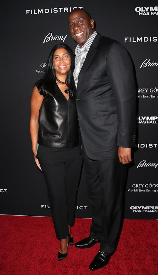 "HOLLYWOOD, CA - MARCH 18: Cookie Johnson (L) and Earvin ""Magic"" Johnson  attend the Premiere of FilmDistrict's ""Olympus Has Fallen"" at the ArcLight Cinemas Cinerama Dome on March 18, 2013 in Hollywood, California.  (Photo by Frederick M. Brown/Getty Images)"