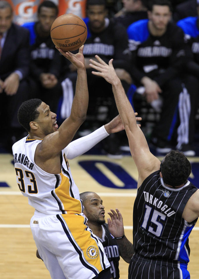 Indiana Pacers' Danny Granger is fouled by Orlando Magic's Hedo Turkoglu as he goes up for a shot during the second half of the second game of an NBA first-round playoff basketball series, Monday, April 30, 2012, in Indianapolis. (AP Photo/Darron Cummings)
