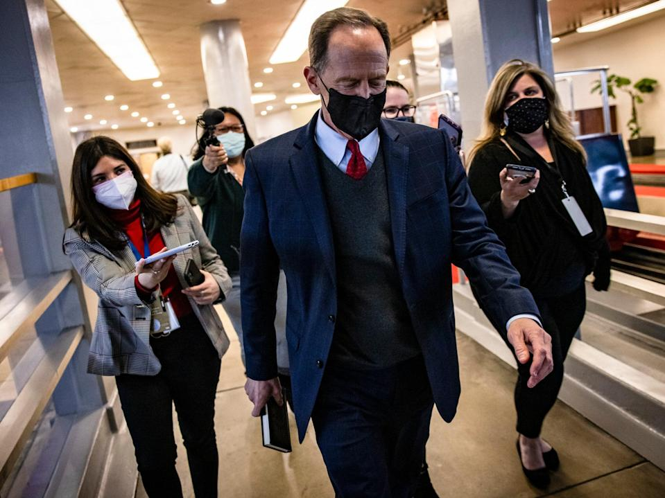 Senator Pat Toomey walks through the Senate subway after the end of Mr Trump's second impeachment trial on February 13, 2021.  (Getty Images)