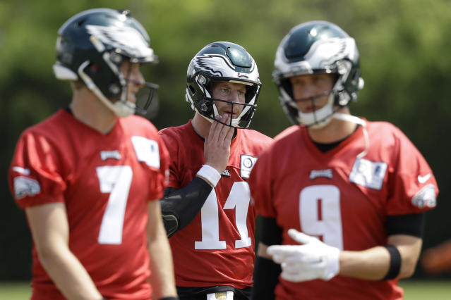 FILE - In this Thursday, June 7, 2018, file photo, Philadelphia Eagles quaterbacks Carson Wentz (11), Nick Foles (9), and Nate Sudfeld (7) walk to the next drill during practice at the NFL football team's training facility in Philadelphia. Wentz was having an MVP season before a torn ACL forced him to the sideline where he watched Nick Foles lead the Philadelphia Eagles to their first Super Bowl victory. His friendship with Super Bowl MVP Nick Foles appears without the strain seen in other famed NFL tandems. (AP Photo/Matt Slocum, File)