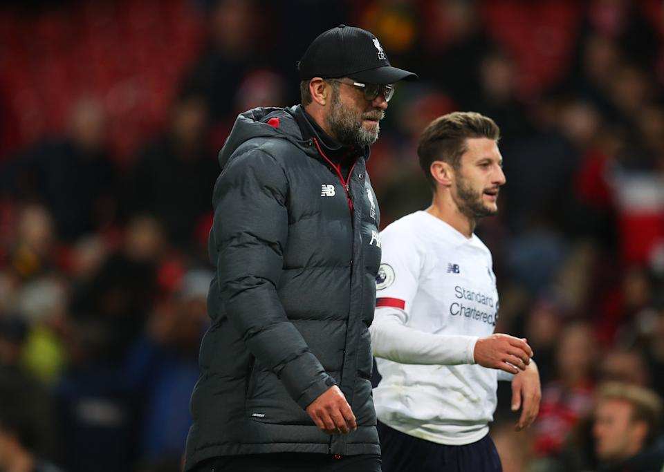 MANCHESTER, ENGLAND - OCTOBER 20: Jurgen Klopp, Manager of Liverpool and Adam Lallana of Liverpool look on during the Premier League match between Manchester United and Liverpool FC at Old Trafford on October 20, 2019 in Manchester, United Kingdom. (Photo by Catherine Ivill/Getty Images)